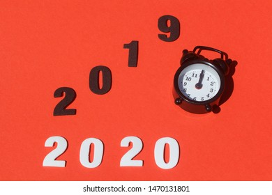 2020, 2019 and black alarm clock for new year