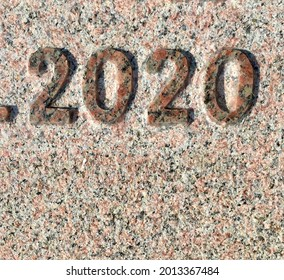 """""""2020"""" chiselled out of granite – a detail of an inscription produced that year"""