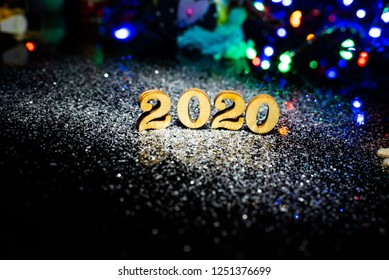 2020 Christmas decorations, spruce branches on dark wooden background