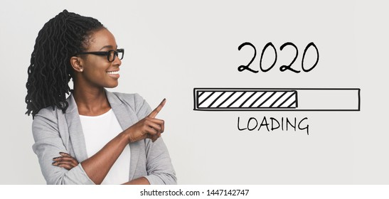 2020 coming soon. Positive african business woman pointing at loading bar, panorama
