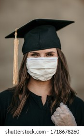 2020 girl graduate in a mask and gloves for Covid-19 and corona virus pandemic