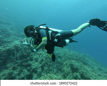 2020 July. Antalya, Turkey. A woman has dived in the deep blue sea.