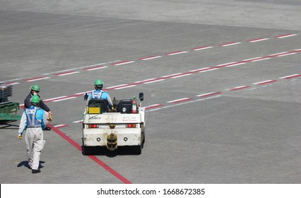 2020 March 04. Chiba JAPAN. Airport ground engineer stuff working on sunny day at runway of Narita International Airport.