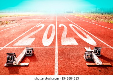 2020 New Year celebration on the racing lane with starting block. New Year arrival concept