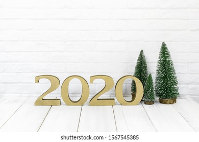 2020 new year and christmas tree on white wood table over white background with empty space