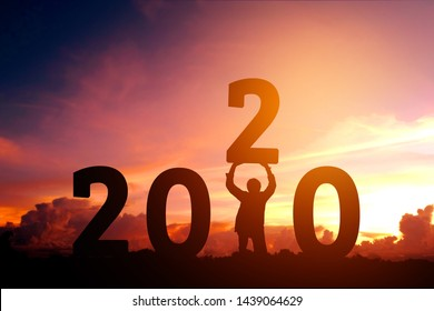 2020 Newyear Man tries to Lift up number of 2020 Happy new year concept