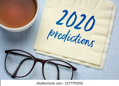 2020 predictions - handwriting on a napkin with a cup of tea, business and financial trends and expectations in New Year