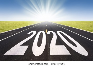 2020 road perspective with rising sun, new year card