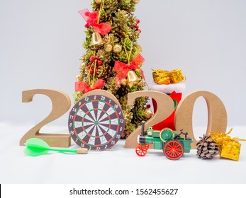 2020 wooden character, Christmas tree and dart board with decoration on white background, Have a nice holiday on this Christmas and new year.