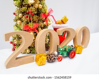 2020 wooden character and Christmas tree with decoration on white background, Have a nice holiday on this Christmas and New Year.