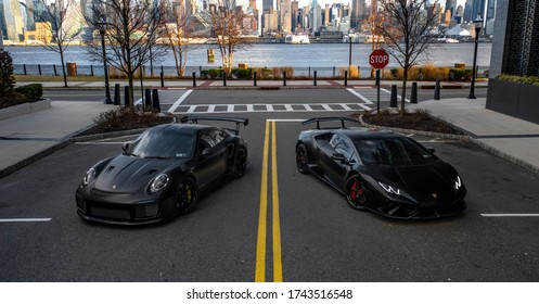 2020.04.14 Hoboken, New Jersey - Porsche 911 GT2RS with a Lamborghini Huracan Performante and the New York City skyline in the back.