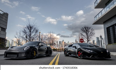 2020.04.15 Hoboken, New Jersey Porsche 911 GT2RS next to Lamborghini Huracan Performante with new York in the back.