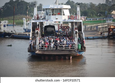 2020,March,20,Hainoi,Vietnam,People in Vietnam board a ferry to wait to cross over to work