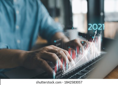 2021 business finance technology and investment concept. Stock Market Investments Funds and Digital Assets. businessman analysing forex trading graph financial data. Business finance background.