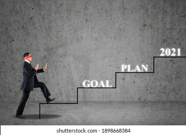 2021 business strategy concept, businessman try to step up to cross the year 2021.