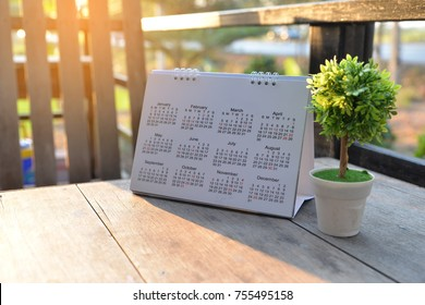 2021 Calendar desk place on table. Desktop Calender for Planner to plan agenda, timetable, appointment, organization, management each date, month, and year on wooden office table.Calendar Concept.