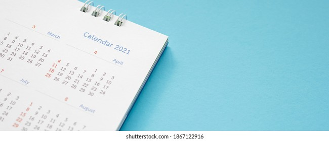 2021 calendar page on blue background business planning appointment meeting concept - Shutterstock ID 1867122916
