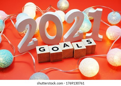 2021 Goals alphabet letters with space copy on red background