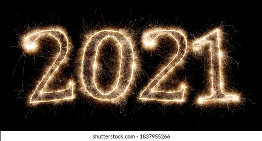 2021 happy new year eve bright glowing golden pyrotechnics sparkler fireworks number isolated on black background
