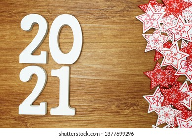 2021 happy new year with whit and red star ornament decoration on wooden background