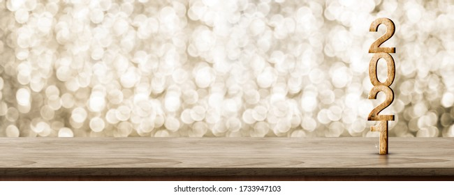 2021 happy new year wood number (3d rendering) on wood table with sparkling gold bokeh wall,leave space for display of product for promotion on christmas and new year holiday
