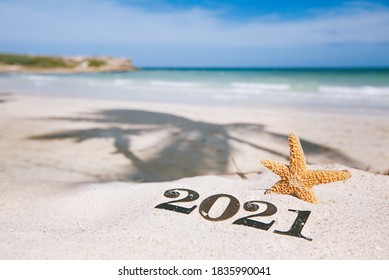 2021 letters with starfish, ocean, beach and seascape