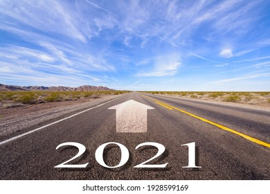 2021 New year and arrow on the road background with blue sky