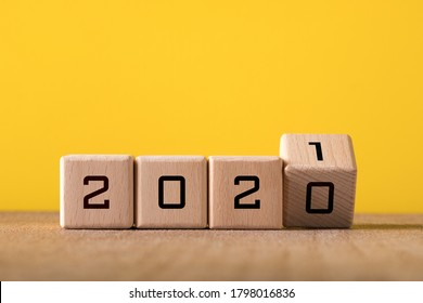 2021 new year background concept. Wooden and yellow background.