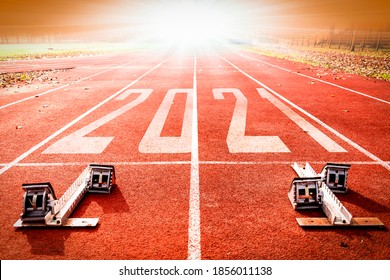 2021 New Year celebration on the racing lane with starting block. New Year arrival concept