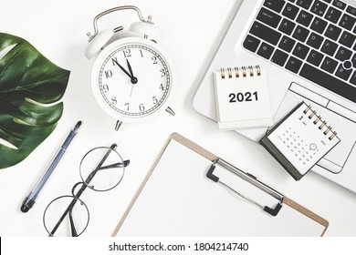 2021 new year goal, plan, action. Flat lay composition office desk with laptop and calendar. to do list