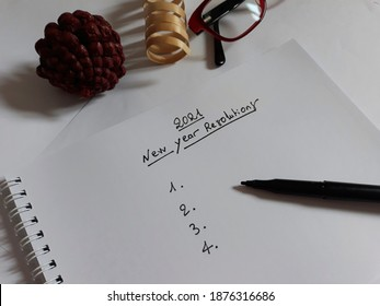 2021 New Year's Resolutions written on notebook.