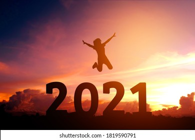 2021 Newyear Silhouette young woman jumping to Happy new year concept.