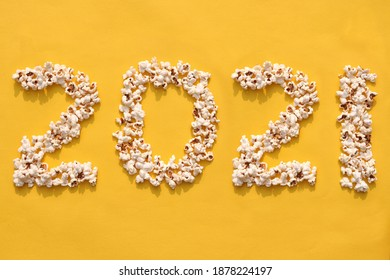 2021 Written with Popcorn on Yellow Background, Creative Photo of Happy New Year 2021, Perfect for Wallpaper