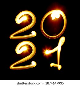 2021 year. Number created by light on the black background. Light painting photography, lettering