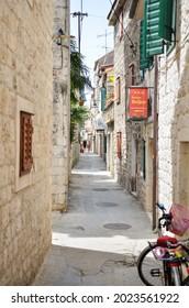 2021.08.01 - Trogir, Croatia: Narrow streets of old town of Trogir in Dalmatia, Croatia, located at the coast of Adriatic sea near city of Split, with traditional Croatian architecture.