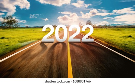 2022 written on highway road in the middle of empty asphalt road and beautiful blue sky. Concept for Trend Vision 2022.