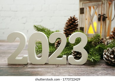 2023 Happy New Year with christmas lantern decorative with space copy on wooden background