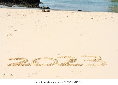 2023 in the sand with whitespace copyspace for editing