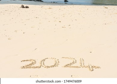 2024 in the sand with whitespace copyspace for editing
