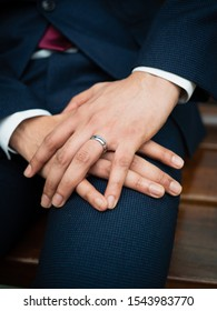 20-29 years Bangladeshi male hands crossed with wedding ring after wedding, weaering suite and shirt.