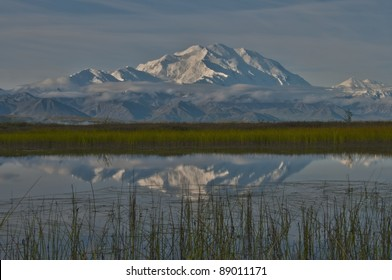 20320' Mount McKinley and the Alaska Range reflects into a pond, Denali National Park, Alaska.
