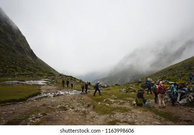 20-April-2018, Salkantay Mountain, Peru, South America. Trekkers in the Peruvian Andes on the Salkantay trek to Machu Picchu.