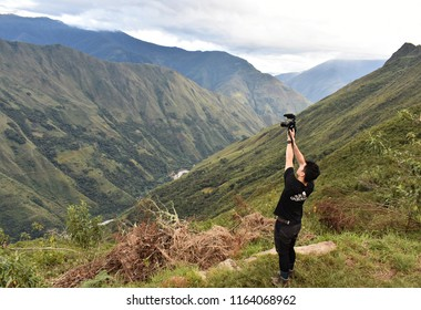 20-April-2018, Salkantay Mountain, Peru, South America. Tourist taking pictures on the Salkantay trek to Machu Picchu.
