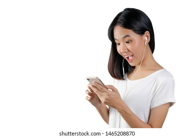 20s an Asian young woman enjoying the movie in mobile phone. She watching the comedy movie.