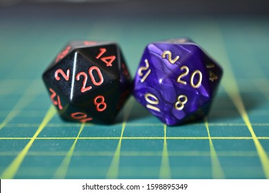 20-sided dice showing two number 20 (2020) with a green and slightly out of focus background