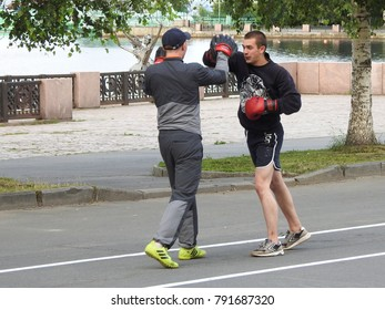 20th of July 2017 - Scene from embankment along Lake Onega with young boxer and his sparring partner, Petrozavodsk, Russia