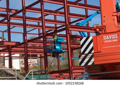 20th March 2018- The steel frame of a new office block being constructed near the riverside at Carmarthen, Carmarthenshire, Wales, UK.