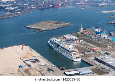 21 April 2019, IJmuiden, Holland. Aerial view of cruise ship AIDAluna at passengers terminal in a dutch port at North Sea Canal. In the back fortress island IJmuiden and factory Tata Steel.