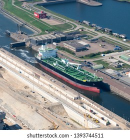 21 April 2019,IJmuiden, Holland. Aerial view of green freight ship Arcos at the new sluice in IJmuiden. For the largest ships a new sea lock is now being built in the Noordzeekanaal.
