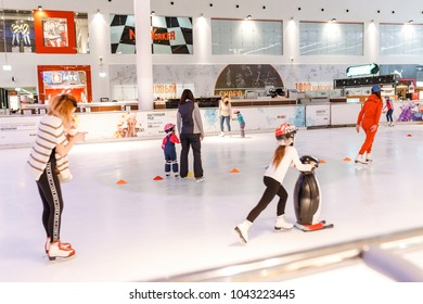21 FEBRUARY 2018, MEGA MALL, UFA, RUSSIA: Kids at indoor ice skating in modern shopping mall